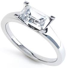 wedding band that will go with my east west oval e ring west 4 claw emerald engagement ring