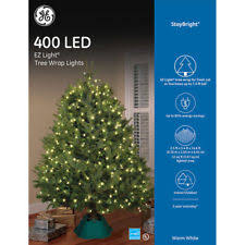 itwinkle christmas tree 2ge itwinkle 7 5 ft musical outdoor indoor christmas tree 300