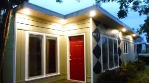 exterior led soffit lighting with wood wall siding and door