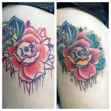 david meek tattoos freehand skull and rose traditional thigh tattoo
