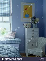 wicker chair for bedroom white wicker chair and white chest of drawers in blue country stock
