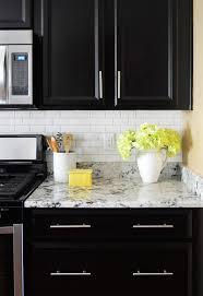 black kitchen cabinets with white subway tile backsplash how to install a subway tile kitchen backsplash