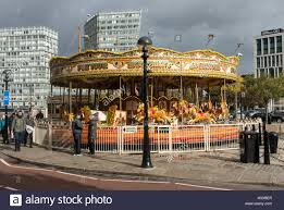 a roundabout or merry go fairground ride by pier on the
