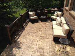 Cracked Concrete Patio Solutions by Raised Stamped Concrete Patio With Timber Tech Express Rail