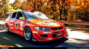 mitsubishi rally car team orange evolution show car tuned international