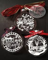christmas ornament with floating papercut inside paper ink and