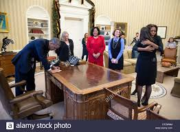 Oval Office Desk by Us President Barack Obama Signs Items At The Resolute Desk After