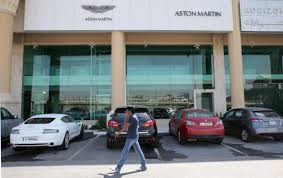 aston martin showroom aston martin recalls 17 590 cars due to counterfeit material