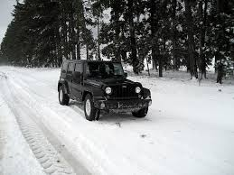 jeep wrangler in the winter 7 jeep essentials for your winter adventures extremeterrain com