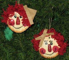these adorable raggedy ornaments are painted gourds with