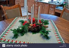 christmas table centerpiece with evergreen boughs pinecones red