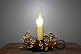 electric candle l with pip berries and dipped bulb
