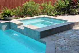 Travertine Floor Cleaning Houston by Swimming Pool Square Spa With Tile Spillover Travertine Deck
