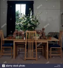 Tall Back Chairs by Tall Back Wooden Stick Back Chairs And Simple Table With