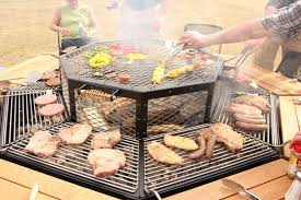 sit around grill table every guest can cook their own steak on this octagonal jag grill