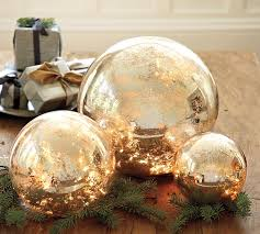 mercury glass ball lights saw these stuffed with string lights in the pottery barn window