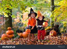 children wearing black orange witch costumes stock photo 460141924