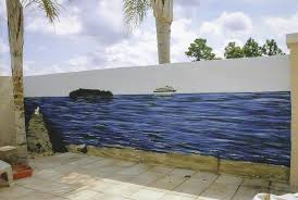 commissioned murals interior exterior personal business 5 x 20 mural painted on an outdoor cement wall in florida 1 000