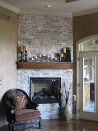 painted brick fireplace with grey color stone fireplace on beige