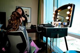 professional makeup artist lighting hair and makeup at hotel twist