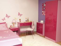red pink wooden wardrobe next to red pink wooden chest of drawers