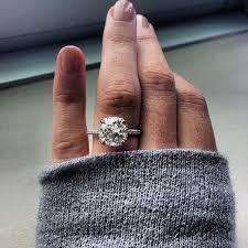 thin band engagement ring picture of a white gold thin band engagement ring with a cushion