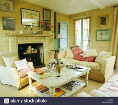 Country Livingroom by White Painted Coffee Table In Cosy Country Living Room With