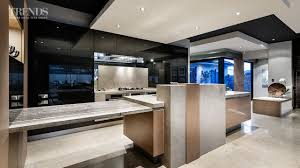 galley kitchen design merges with large living space and links to