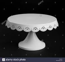 metal cake stand white metal cake stand on black background stock photo 135283156