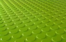 there is something about this vibrant green rubber flooring from