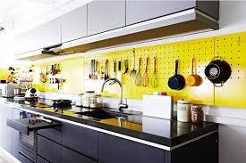 pegboard kitchen ideas yellow pegboard backsplash with black cabinet for modern
