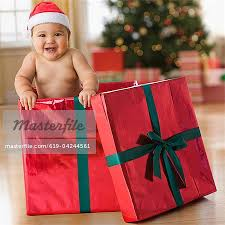 baby boy christmas mixed race baby boy in christmas gift box stock photo