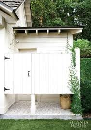 build an outdoor shower with timber and corrugated sheeting