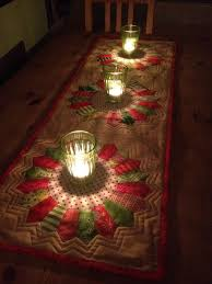 make christmas table runner really pretty table runner looks so cool with the candlelight