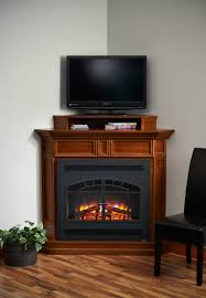 Corner Gas Fireplace With Tv Above by Corner Brown Wooden Fireplace With Black Steel Frame And Glass