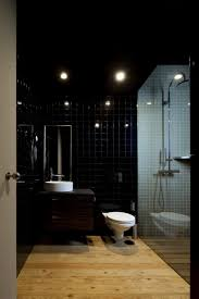 a dark colored bathroom