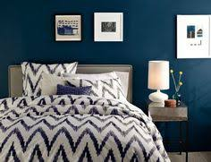 the bold color scheme and patterns in this bedroom make it a