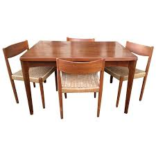 extendable teak dining table danish modern extendable teak dining table with woven chairs at 1stdibs