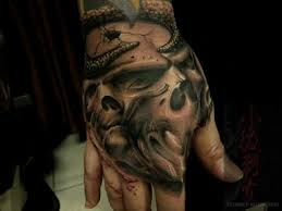 free tattoo designs hand and skull tattoo design