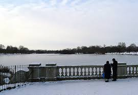 park snow frozen serpentine lake snow covered park and