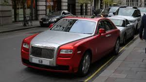 roll royce red car on street at night free stock photo