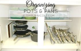 how to organize pots and pans in a cupboard organizing pots and pans simply