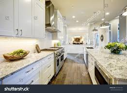 white kitchen design features large bar stock photo 557476195