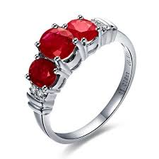 ruby stone rings images Three stone ruby and diamond engagement ring on 9ct white gold jpg