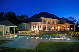 decorative outdoor landscape lighting around swimming pool with