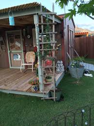 tobacco ladders from arkansas used as a trellis on the corner of