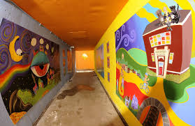 pinckney tunnel murals ljworld com bright colored mural panels now line both walls the length of the pinckney elementary school tunnel beneath sixth street