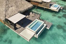 hammock floors take overwater bungalows to a new level of luxury