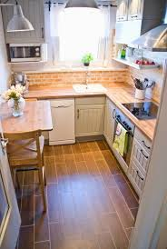 backsplashes for small kitchens tiny kitchen makeover with painted backsplash and wood tile floors