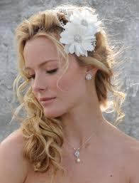 side ponytail wedding hairstyle with flowered headband 05 latest